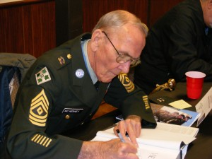 Signing my MoH book earlier this year