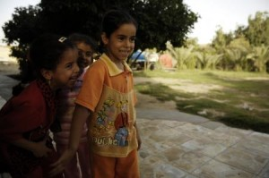 Three Iraqi girls giggle as they watch Iraqi and U.S. Soldiers perform a routine search of their house and surrounding land during a joint patrol in Shula, Iraq, on June 19, 2008. The U.S. Soldiers are part of 3rd Platoon, Bravo Company, 2nd Brigade, 502nd Infantry Regiment. (DVIDSHUB)
